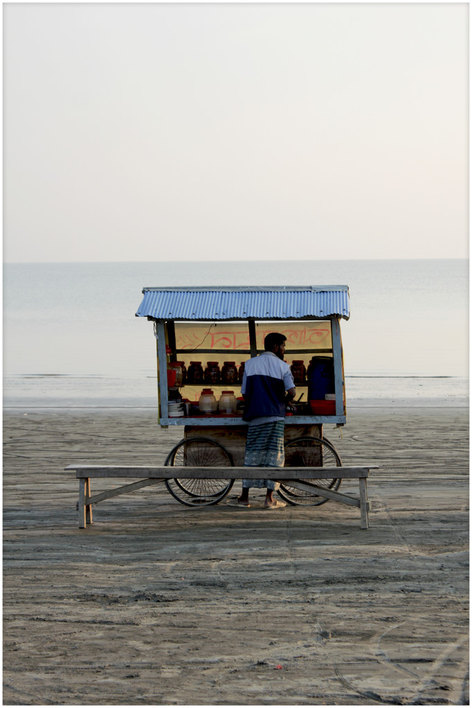 Man with his cart on the beach of Kuakata