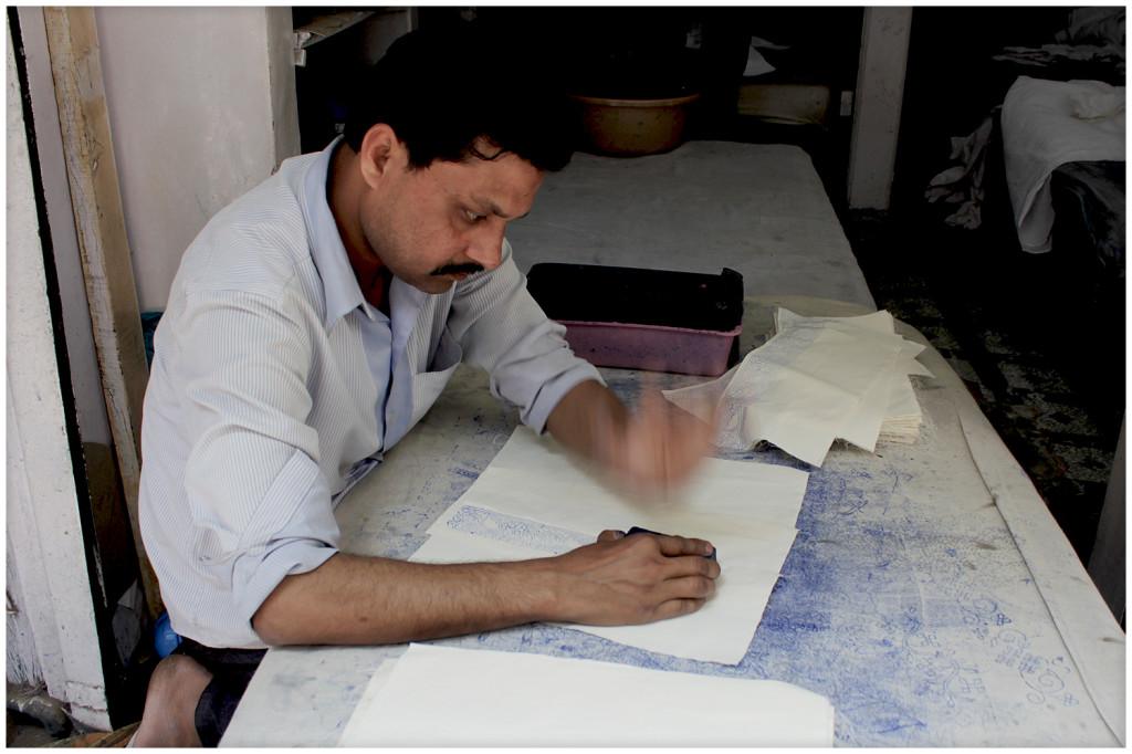 Man stamping fabrics