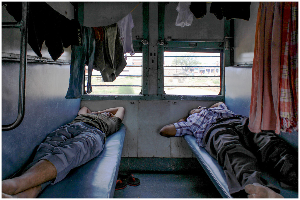 Two men sleeping in the train on the way to Jaipur