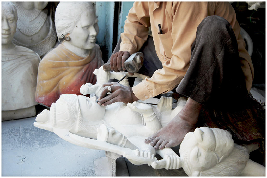 Sculptor making an image of a god