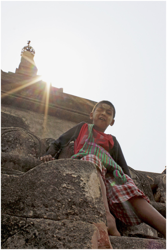 Kid climbing the temples in Bagan