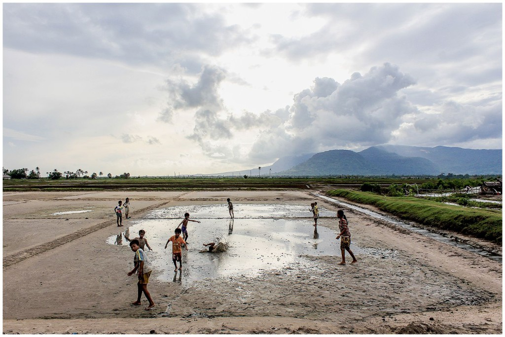 Kids playing in the Kampot salt fields